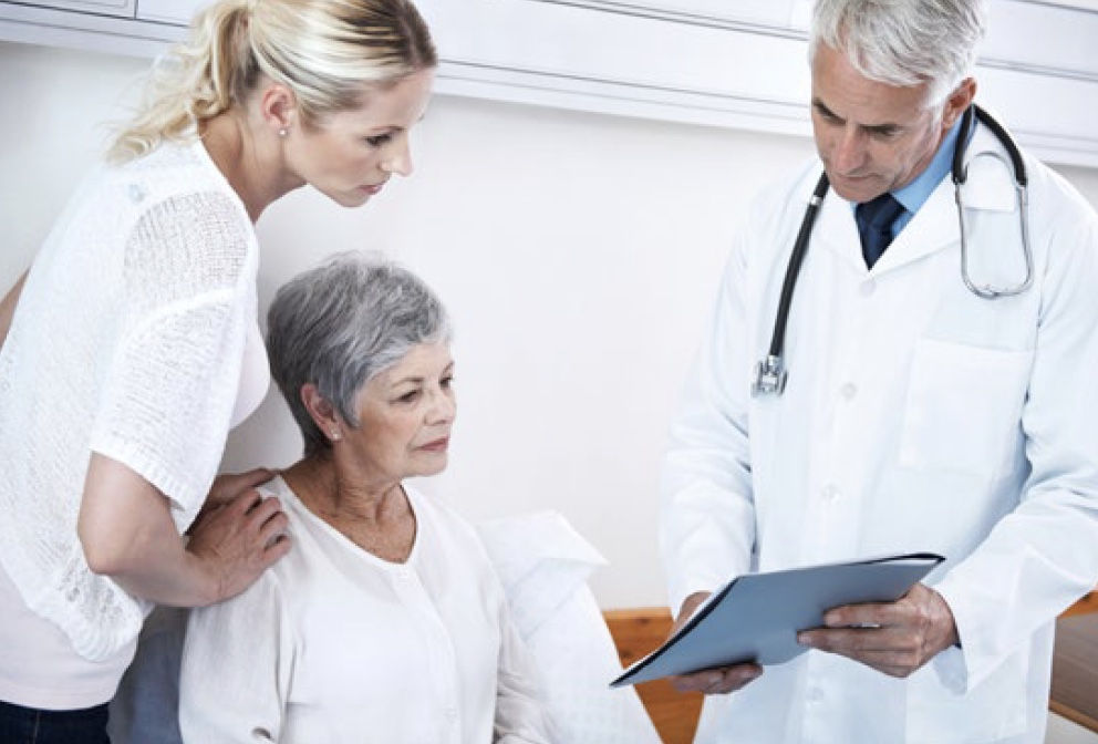 Physician Discusses details with his patient
